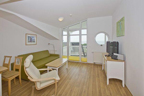 gemütlicher Wohnbereich in der Ferienwohnung 17 in den Meeresblick Residenzen